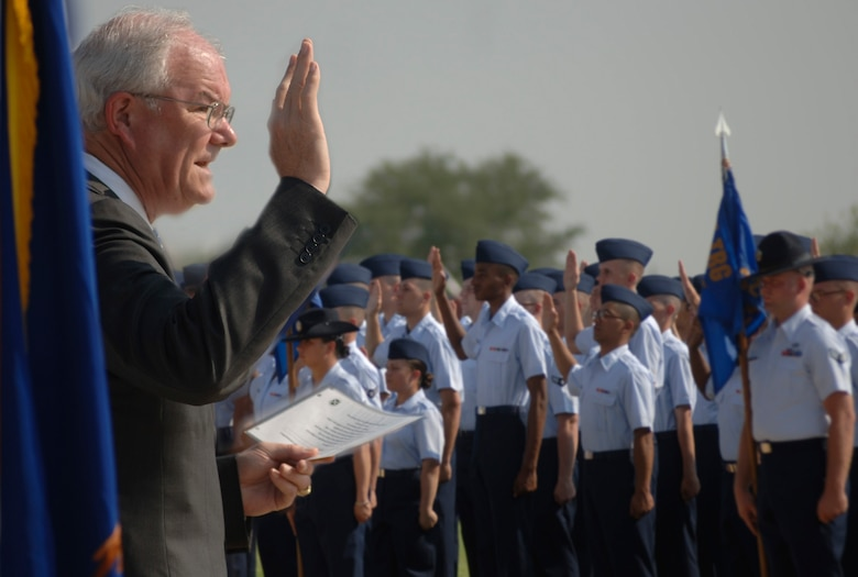 Secretary of the Air Force Michael W. Wynne administers the Oath of Enlistment to basic training graduates on the parade grounds at Lackland Air Force Base, Texas, on Friday, June 2, 2006. Secretary Wynne was in San Antonio visiting various military installations and training sites. (U.S. Air Force photo/Tech. Sgt. Cecilio M. Ricardo Jr.)