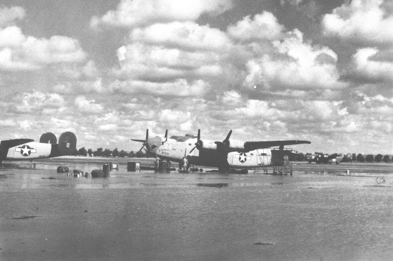 "Consolidated B-24D ""Strawberry Bitch"" at the 58th Service Squadron depot (c. October 1943). Note the vertical stabilizers have been removed. (U.S. Air Force photo)"