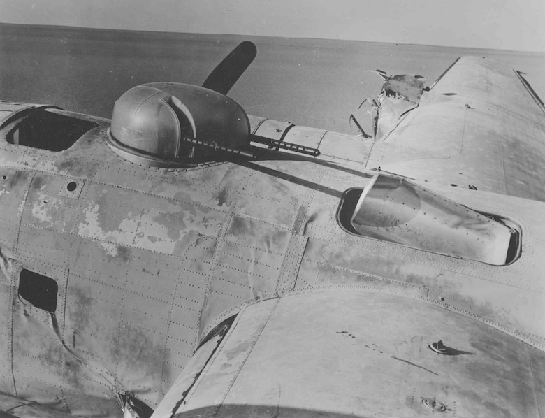 "Top turret and center fuselage wreckage of the Consolidated B-24D ""Lady Be Good."" (U.S. Air Force photo)"
