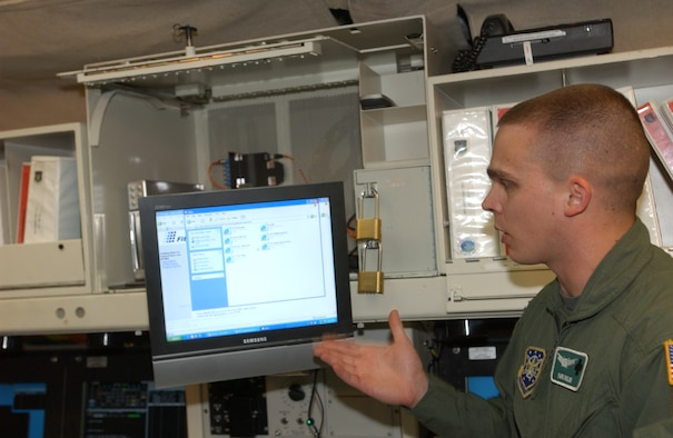 Capt. Mark Bigley, 741st Missile Squadron combat crew commander, explains how Juliet-01's new computer with Internet access works within the launch control center May 30. The system, Netlink, allowing Internet access will undergo an initial trial phase of 60 days to collect data on the success of the new system. If the results deem positive then a blanket approval will be sought to install the same system at all 15 missile alert facilities within the 91st Space Wing. U.S. Air Force photo by Airman 1st Class Cassandra Butler)