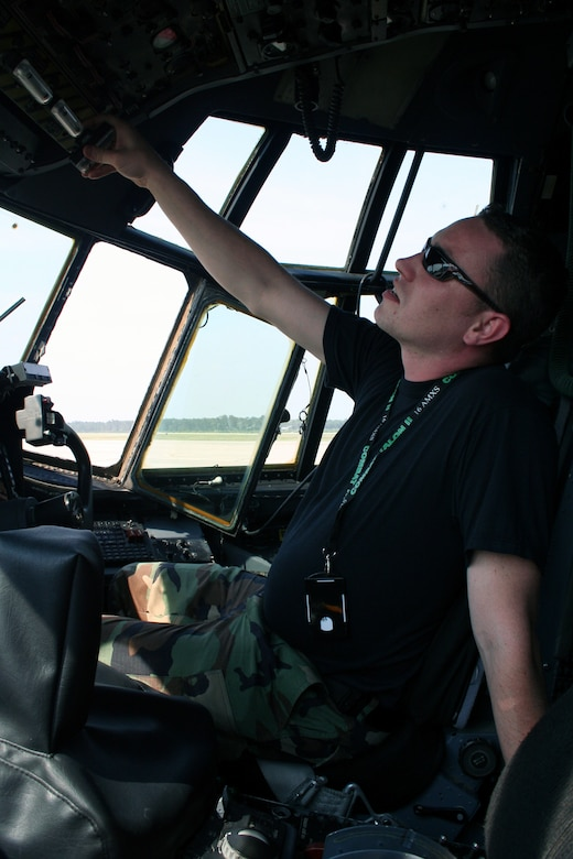 Senior Airman Steven Ogden, a 15th AMU guidance control specialist, checks the fuel quantity gauges on an MC-130H Combat Talon II as part of the ORI.