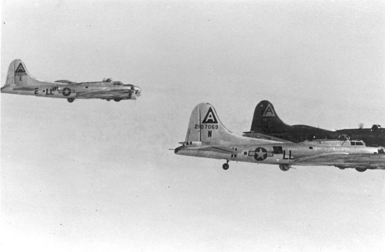 "Boeing B-17G ""Shoo Shoo Shoo Baby"" (LL-E) in flight in 1944. Foreground aircraft is B-17G-35-DL (S/N 42-107069) (LL-N). (U.S. Air Force photo)"
