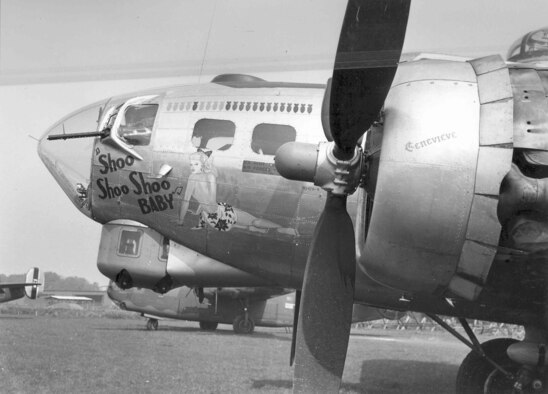 """Boeing B-17G """"Shoo Shoo Shoo Baby"""" original nose art. The aircraft was never painted when assigned to the 91st Bomb Group; however, it is displayed at the museum painted to conceal the extensive sheet metal work necessary to return the aircraft to its wartime condition. (U.S. Air Force photo)"""