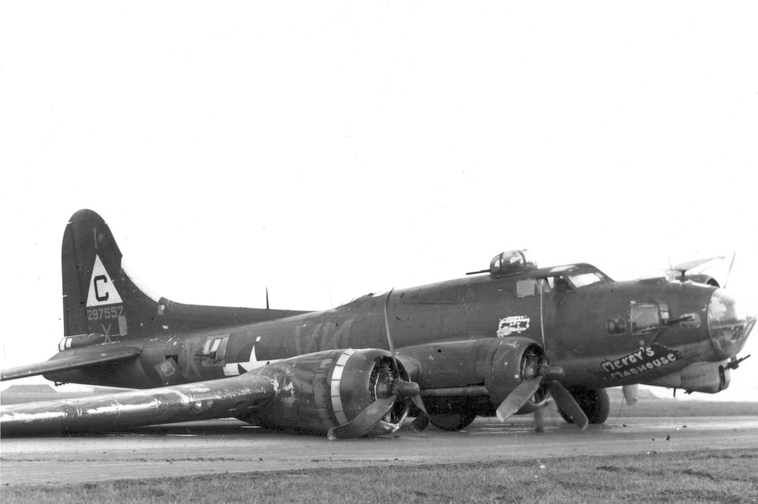 """Boeing B-17G-20-VE (S/N 42-97557) """"Mercy's Madhouse"""" (VK-X) of the 303rd Bomb Group, 358th Bomb Squadron, after a wheels-up emergency landing on Dec. 7, 1944. (U.S. Air Force photo)"""