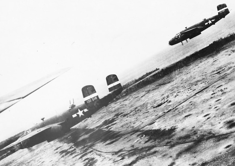 North American B-25s in action over Gloucester in December 1943. (U.S. Air Force photo)