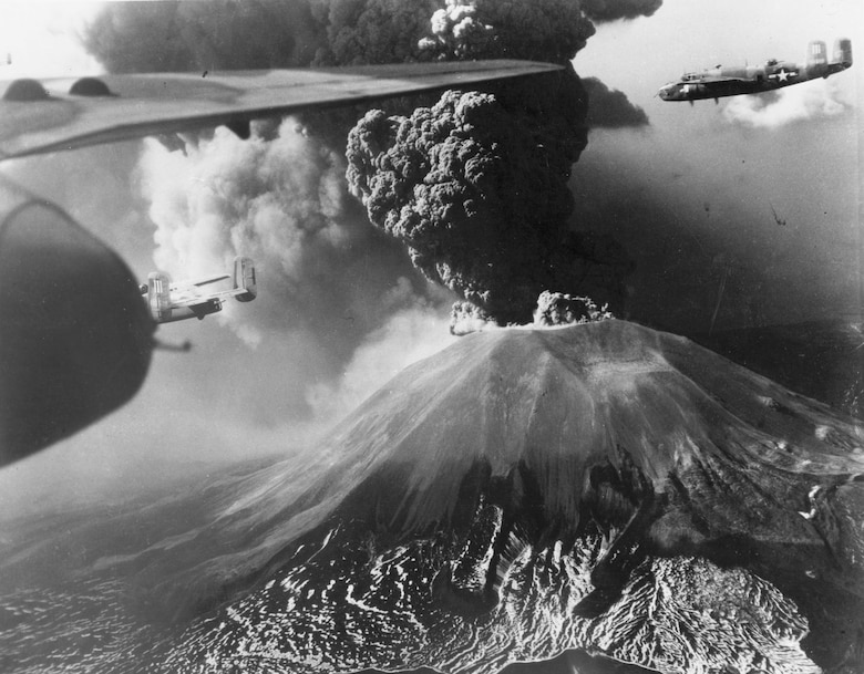 North American B-25s fly past Mount Vesuvius during an eruption. (U.S. Air Force photo)