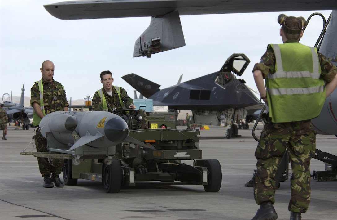 Sgt. Brian Scott (left), Cpl. Dave Parkinson (right), and Senior Aircraftsman Gary Shackleton (middle), weapons technicians from the IX Bomb Squadron, Royal Air Force, United Kingdom, load an outboard store to a GR-4 Tornado. The Royal Air Force is at Nellis to take part in Red Flag, an exercise that tests aircrew war-fighting skills in real-time combat situations. Red Flag involves more than 200 aircraft ranging from B-52 Stratofortresses to F-16 Fighting Falcons. The exercise will run through Feb. 18.
