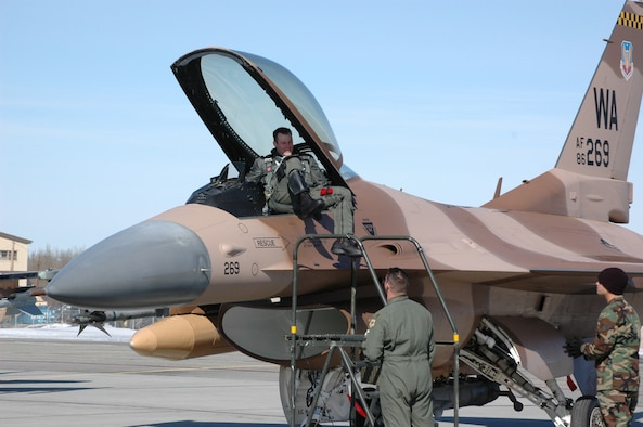 Maj. Sean Routier, 64th Aggressor Squadron pilot, climbs down from his F-16 Fighting Falcon April 17, 2006 at Eielson AFB, Alaska. The Aggressors will be participating in the first-ever Red Flag - Alaska exercise, which begins April 24 and continues for two weeks.
