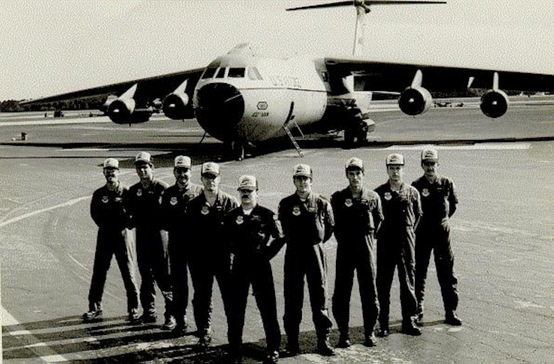 The 1983 edition of the 315th Military Airlift Wing's Rodeo pose in front of their C-141B Starlifter.  (USAF Historical Photograph)