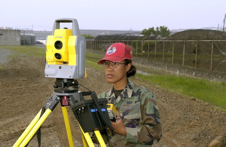 Staff Sgt. Celeste Perry uses surveying equipment at a construction site in Kimhae, South Korea, on Wednesday, May 24, 2006. Airmen from Red Horse squadrons at Nellis Air Force Base, Nev.; Barksdale AFB, La.; Andersen AFB, Guam, and Osan Air Base, South Korea, are working through September on various quality-of-life improvement projects in South Korea. Sergeant Perry is with Osan's 554th Red Horse Squadron. (U.S. Air Force photo/Tech. Sgt. Demetrius Lester)