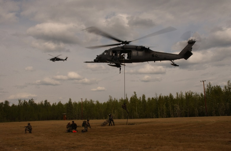 Airmen from the 31st Rescue Squadron at Kadena Air Base, Japan, fast-rope out of an HH-60 Pave Hawk during a combat search and rescue mission for exercise Northern Edge 2006 at Fort Wainwright, Alaska, on June 6, 2006. Northern Edge is a joint training exercise hosted by Alaskan Command and is one of a series of U.S. Pacific Command exercises that prepare joint forces to respond to crises in the Asian Pacific region. (U.S. Air Force photo/Staff Sgt. Joshua Strang)