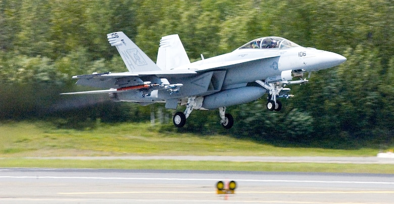 "An F/A-18F Super Hornet assigned to the ""Black Aces"" of Strike Fighter Squadron Four One takes off from Elmendorf Air Force Base, Alaska, during exercise Northern Edge 2006. The joint training exercise hosted by Alaskan Command is one of a series of U.S. Pacific Command exercises that prepare joint forces to respond to crises in the Asian Pacific region. (U.S. Air Force photo/Senior Airman Garrett Hothan)"