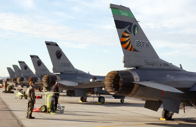 F-16 Fighting Falcons from Iowa and Ohio Air National Guard units sit ready on the flightline at Eielson Air Force Base, Alaska, on Tuesday, June 6, 2006, during Exercise Northern Edge 2006. The joint training exercise hosted by Alaskan Command is one of a series of U.S. Pacific Command exercises that prepare joint forces to respond to crises in the Asian Pacific region. (U.S. Air Force photo/Staff Sgt. Joshua Strang)