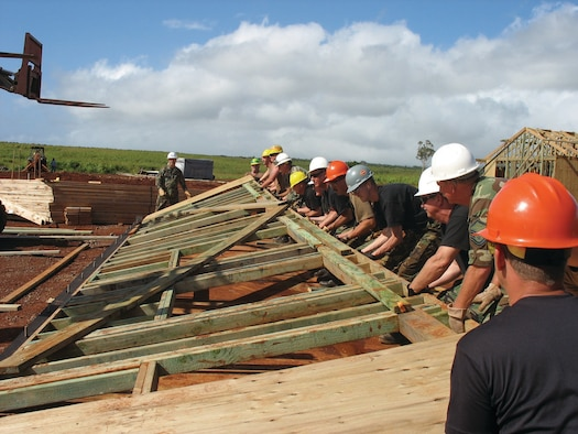 Members with the first rotation of the 931st CES team up to lift part of a frame into place. The 931st CES took part in the Innovative Readiness Project from April 29 to May 28.