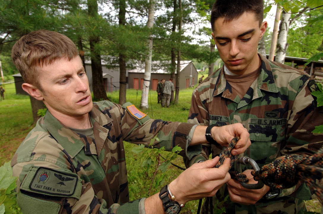 Tech. Sgt. Dana Vaughan helps Army ROTC Cadet William Maloney construct a rope bridge on Thursday, June 8, 2006. Sergeant Vaughan, a pararescueman from Nellis Air Force Base, Nev., is attending a two-week summer mountaineer training course at the Vermont National Guard's Army Mountain Warfare School in Jericho, Vt. (Air National Guard photo/Master Sgt. Rob Trubia)