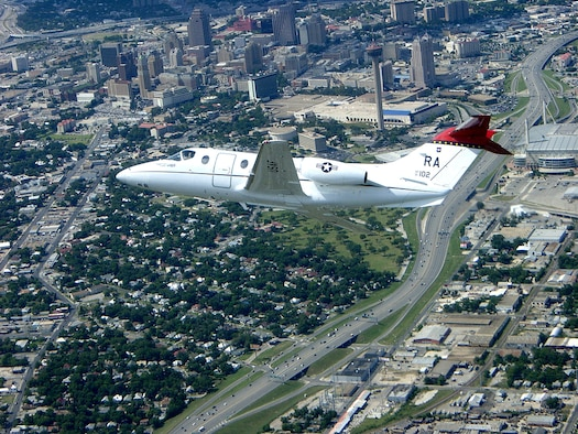 A T-1A Jayhawk flies over downtown San Antonio. The aircraft is assigned to the 99th Flying Training Squadron at Randolph Air Force Base, Texas. (U.S. Air Force photo/Lt. Col. Russell Hopkinson)
