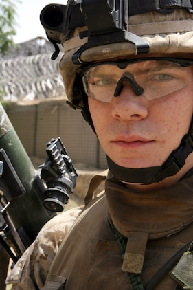 """Lance Cpl. Richard M. Mason II serves as an assaultman for 2nd Platoon, Company K, 3rd Battalion, 8th Marine Regiment. Nicknamed the """"Rocket Man,"""" the 21-year-old from Medina, Ohio has effectively fired 24 rockets using the Shoulder-Launched Multi-Purpose Assault Weapon or SMAW during combat operations in Ramadi. The portable anti-armor rocket launcher has the sole purpose of destroying bunkers and other fortifications during assault operations."""