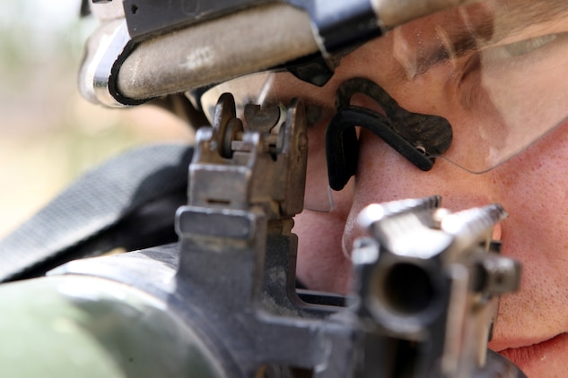 """Lance Cpl. Richard M. Mason II, an assaultman for 2nd Platoon, Company K, 3rd Battalion, 8th Marine Regiment, prefers using iron sights when aiming on a target. Nicknamed the """"Rocket Man,"""" the 20-year-old from Medina, Ohio has effectively fired 24 rockets using the Shoulder-Launched Multi-Purpose Assault Weapon or SMAW during combat operations in Ar Ramadi. The portable anti-armor rocket launcher has the sole purpose of destroying bunkers and other fortifications during assault operations. 3/8 is currently deployed with I Marine Expeditionary Force (Forward) in support of Operation Iraqi Freedom in the Al Anbar province of Iraq to develop the Iraqi Security Forces, facilitate the development of official rule of law through demographic government reforms, and continue the development of a market based economy centered on Iraqi reconstruction.   USMC photo by Cpl. Joseph DiGirolamo  060610-M-0008D-003"""