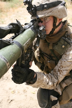 """Lance Cpl. Richard M. Mason II serves as an assaultman for 2nd Platoon, Company K, 3rd Battalion, 8th Marine Regiment. Nicknamed the """"Rocket Man,"""" the 20-year-old from Medina, Ohio has effectively fired 24 rockets using the Shoulder-Launched Multi-Purpose Assault Weapon or SMAW during combat operations in Ar Ramadi. The portable anti-armor rocket launcher has the sole purpose of destroying bunkers and other fortifications during assault operations. 3/8 is currently deployed with I Marine Expeditionary Force (Forward) in support of Operation Iraqi Freedom in the Al Anbar province of Iraq to develop the Iraqi Security Forces, facilitate the development of official rule of law through demographic government reforms, and continue the development of a market based economy centered on Iraqi reconstruction.   USMC photo by Cpl. Joseph DiGirolamo  060610-M-0008D-004"""