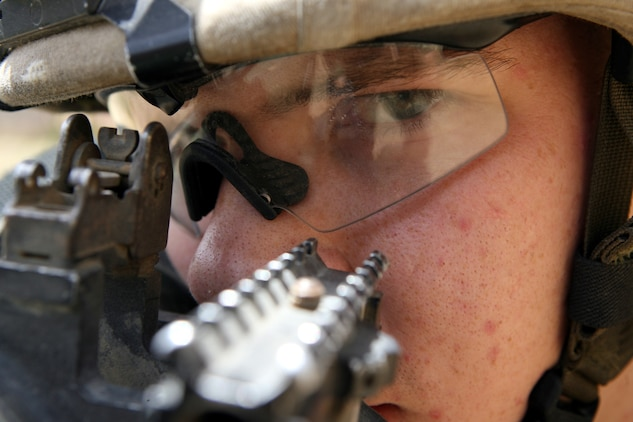 """RAMADI, Iraq - Lance Cpl. Richard M. Mason II, an assaultman for 2nd Platoon, K Company, 3rd Battalion, 8th Marine Regiment, sights down range with his rocket launcher. Nicknamed the """"Rocket Man,"""" the 21-year-old from Medina, Ohio has effectively fired 24 rockets using the Shoulder-Launched Multi-Purpose Assault Weapon or SMAW during combat operations in Ramadi. The portable anti-armor rocket launcher has the sole purpose of destroying bunkers and other fortifications during assault operations."""