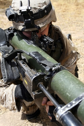 """Lance Cpl. Richard M. Mason II serves as an assaultman for 2nd Platoon, Company K, 3rd Battalion, 8th Marine Regiment. Nicknamed the """"Rocket Man,"""" the 20-year-old from Medina, Ohio has effectively fired 24 rockets using the Shoulder-Launched Multi-Purpose Assault Weapon or SMAW during combat operations in Ar Ramadi. The portable anti-armor rocket launcher has the sole purpose of destroying bunkers and other fortifications during assault operations. 3/8 is currently deployed with I Marine Expeditionary Force (Forward) in support of Operation Iraqi Freedom in the Al Anbar province of Iraq to develop the Iraqi Security Forces, facilitate the development of official rule of law through demographic government reforms, and continue the development of a market based economy centered on Iraqi reconstruction.   USMC photo by Cpl. Joseph DiGirolamo  060610-M-0008D-006"""