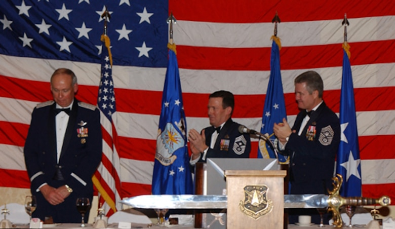 COLORADO SPRINGS, Colo.--Chief Master Sgt. Ron Kriete, command chief master sergeant, Air Force Space Command, served as the sergeant major for the Order of the Sword ceremony Feb. 11 honoring former AFSPC Commander General Lance W. Lord (left).  Chief Master Sergeant of the Air Force Gerald R. Murray (right) was the event's keynote speaker. (U.S. Air Force photo by Duncan Wood)