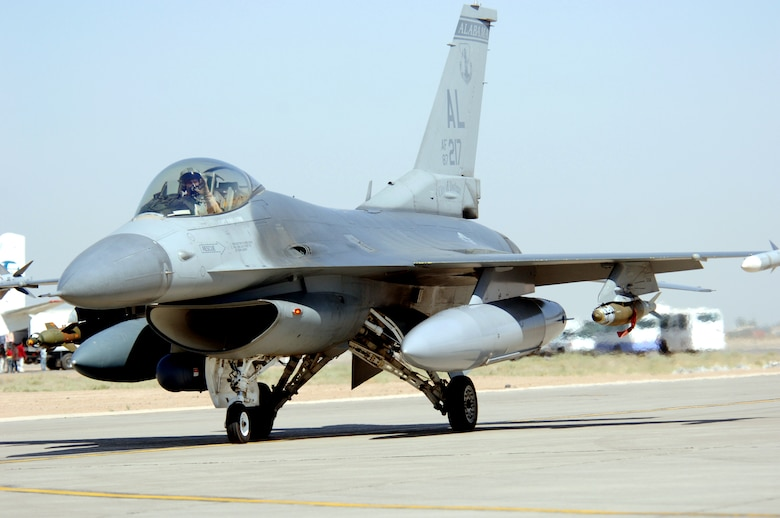 An F-16 Fighting Falcon taxis at Balad Air Base, Iraq, after an Operation Iraqi Freedom mission on Monday, June 12. The F-16 is deployed from the Alabama Air National Guard's 187th Fighter Wing in Montgomery. (U.S. Air Force photo/Staff Sgt. Tony R. Tolley)