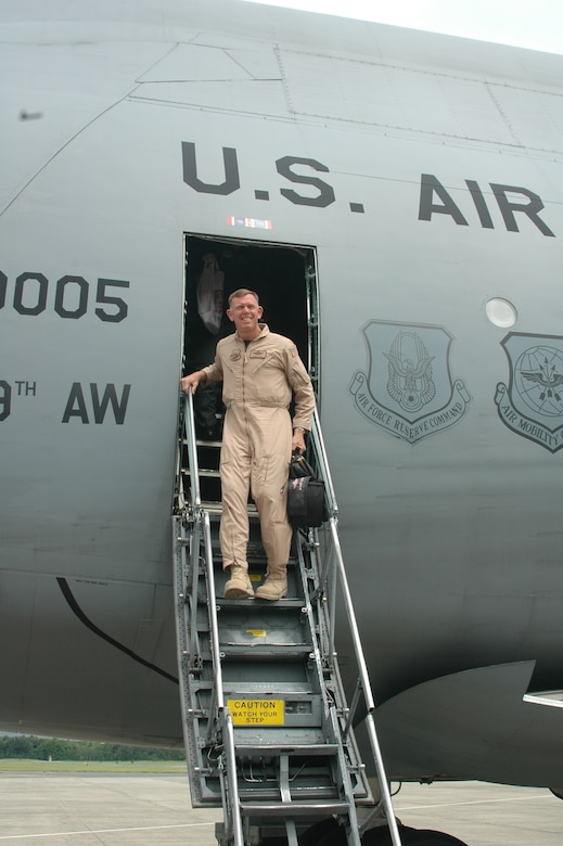 Brig. Gen. Wade Farris, 439th Airlift Wing commander, steps down from a Westover C-5 June 4 following his four-month deployment to a Southwest Asia location in support of Operation Iraqi Freedom. (U.S. Air Force photo/Tech Sgt. Andrew Biscoe)