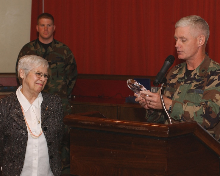 Brig. Gen. Robert Steele, right, 48th Fighter Wing commander, presents Janina Fischler-Martinho, left, a survivor of the Holocaust, with an appreciation award at this year's Holocaust remembrance luncheon at RAF Mildenhall May 3. (U.S. Air Force photo by Senior Airman Cecil McCloud)