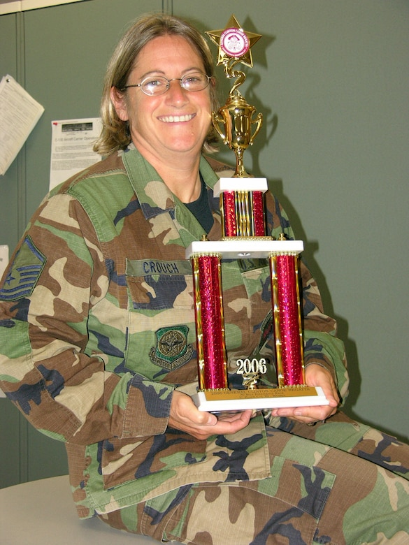 Master Sgt. Helen Crouch holds a trophy she won from a recent canoe regatta she paddled in New York state. (Courtesy photo)