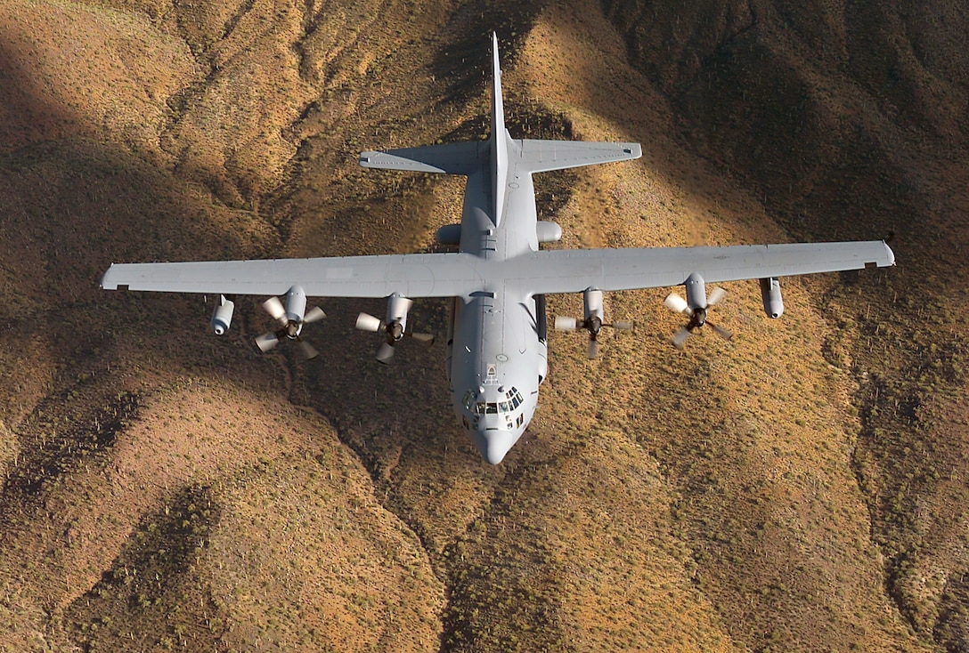 An EC-130H Compass Call flies a training mission over Lake Mead, Ariz. Compass Call is the designation for a modified version of the C-130 Hercules aircraft configured to perform tactical command, control and communications countermeasures. Specifically, the modified aircraft uses noise jamming to prevent communication or degrade the transfer of information essential to command and control of weapon systems and other resources. Modifications to the aircraft include an electronic countermeasures system, air refueling capability and associated navigation and communications systems. (U.S. Air Force photo)