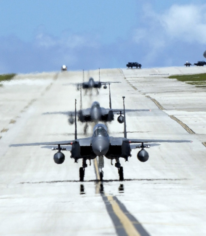 ANDERSEN AIR FORCE BASE, Guam -- F-15E Strike Eagles from the 90th Expeditionary Fighter Squadron taxi to their parking spots on Andersen Air Force Base, Guam. Deployed from Elmendorf Air Force Base, Alaska, the 90th EFS is participating in exercise Valiant Shield 2006. Valiant Shield begins June 19 and lasts through June 23, and will be conducted in the vicinity of Guam. Valiant Shield focuses on integrated joint training among US military forces. (U.S. Air Force photo by Airman 1st Class Michael Dorus)