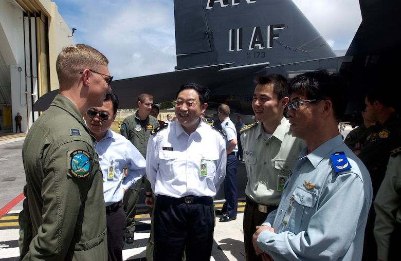 ANDERSEN AIR FORCE BASE, Guam -- Members of the Chinese foreign observer team ask questions about the F-15, during Valiant Shield '06, from an American representative. Foriegn observers were present from China, Russia, India, Australia, the Republic of Korea, Singapore, and Japan. Valiant Shield begins June 19 and lasts through June 23, and will be conducted in the vicinity of Guam. Valiant Shield focuses on integrated joint training among US military forces. (U.S. Air Force photo by Airman First Class Michael S. Dorus)