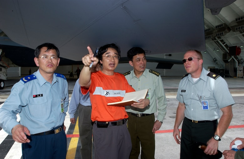 ANDERSEN AIR FORCE BASE, Guam -- Reporters and members of the Chinese foreign observer team ask questions about the F-15, during Valiant Shield '06, from an American representative. Foriegn observers were present from China, Russia, India, Australia, the Republic of Korea, Singapore, and Japan. Valiant Shield begins June 19 and lasts through June 23, and will be conducted in the vicinity of Guam. Valiant Shield focuses on integrated joint training among US military forces. (U.S. Air Force photo by Airman First Class Michael S. Dorus)