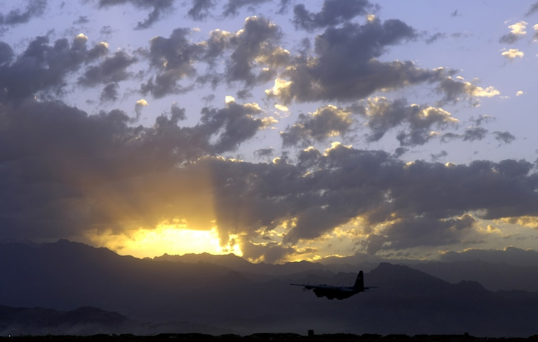 A C-130 Hercules from the 774th Expeditionary Airlift Squadron takes off from Bagram Air Field, Afghanistan, at sunrise on Saturday, June 10. The squadron flies approximately five missions a day, providing airlift and airdrops to troops in theater. (U.S. Air Force photo/Senior Airman Brian Ferguson)