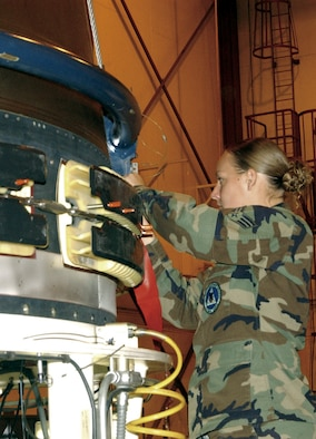 F.E. WARREN AFB, Wyo. – Senior Airman Sarah Holznagel, 90th Missile Maintenance Squadron maintainer, secures explosive ordnance on a Peacekeeper missile. (Photo by 2nd Lt. Josh Edwards)