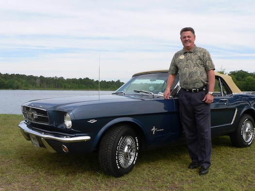 MOODY AIR FORCE BASE, Ga. -- Buddy Chapman, 347th Services Squadron here, shows off his 1965 Ford Mustang he bought after injuring himself during a rodeo in Germany and finding out he could no longer ride horses. Mr. Chapman, a retired chief master sergeant, has spent the last couple years rebuilding his classic car. (U.S. Air Force photo by Senior Airman S.I. Fielder)