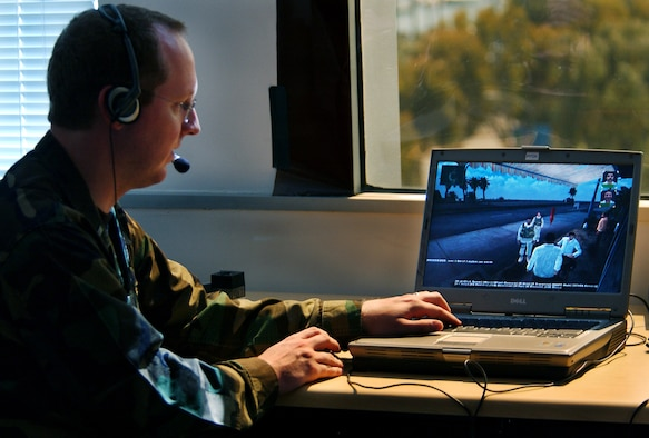 """LOS ANGELES AFB, Calif. – 1st Lt. DeWitt Latimer, Space and Missile Systems Center Space Radar chief software engineer, guides """"Sgt. John Smith"""" through a conversation with an Iraqi native in an immersive game-based language system at the University of Southern California Information Sciences Institute. (Photo by Jason M. Webb)"""