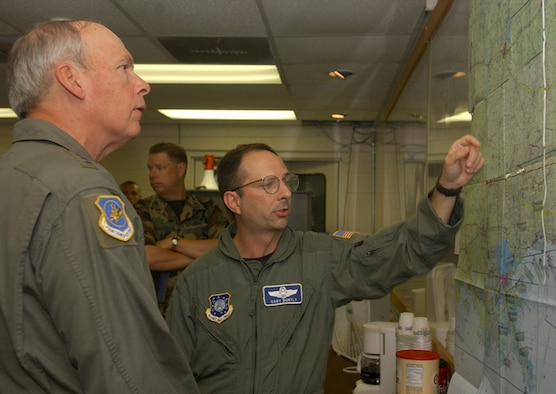 COLUMBUS AFB, Miss. – General Lance W. Lord, Air Force Space Command commander, is briefed here today by Lt. Col. Gary Bontly, 620th Air Expeditionary Squadron commander, about where squadron members are performing Joint Task Force Katrina missions. General Lord; Maj. Gen. Frank Klotz, 20th Air Force commander; and AFSPC Command Chief Master Sgt. Ron Kriete visited Columbus, Keesler AFB and Gulfport, Miss. to meet the more than 220 AFSPC members deployed in support of Hurricane Katrina relief efforts. (Photo by Tech. Sgt. Molly Gilliam)
