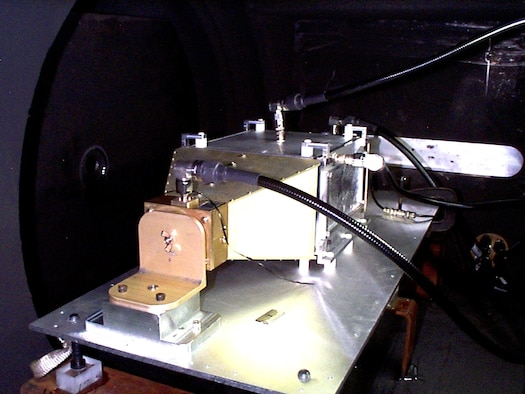 KIRTLAND AIR FORCE BASE, N.M. — Positioned in the Sandia National Laboratories' hypervelocity launcher, the micro-meteoroid impact experiment apparatus awaits a shot from the light gas gun during the initial trials conducted in May 2004.