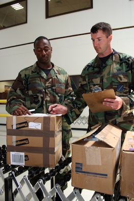 Staff Sgt. Raja Beckles (left) and Tech. Sgt. Chad Steele inventory items at the 39th Logistics Readiness Squadron at Incirlik Air Base, Turkey, on Wednesday, June 21. (U.S. Air Force photo/Staff Sgt. Oshawn Jefferson)