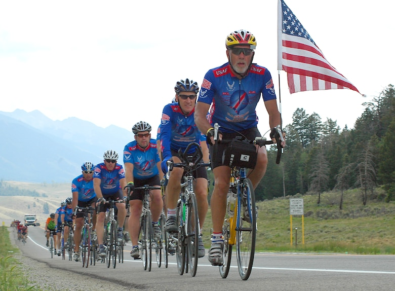 """Led by retired Chief Master Sgt. Robert Kodis and team captain Lt. Col. Stephen Mitchell, the U.S. Air Force Space World Cycling team rides into the Poncha Pass checkpoint on day five of """"Ride the Rockies,"""" a six-day cross-state bicycle tour. Colonel Mitchell is the 50th Operations Group deputy commander."""