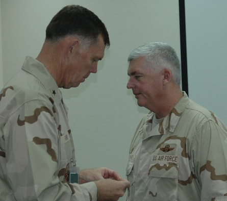 SOUTHWEST ASIA- Former 914th commander, Brig. Gen. WadeFarris, pins the rank of full colonel onto Col. Mark Murphy, 328AS, at a forward deployed location.