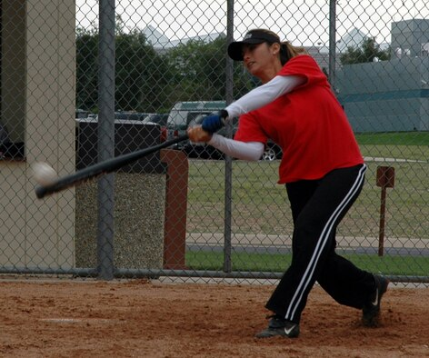 PETERSON AFB, Colo. – Tech. Sgt. Eileen Hendee, Combatant Commanders Command and Control Systems Group NCO in charge of Executive Services at Peterson AFB, connects for a deep drive to center as she practices with the Air Force Women's Softball Team. (Photo by Tech. Sgt. Denise Johnson)