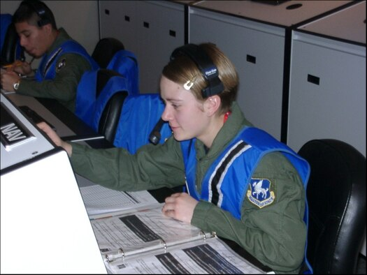 SCHRIEVER AFB, Colo. – Amn. Shalon Hautala (right), 3rd Space Operations Squadron satellite system operator, performs navigation operations during a recent simulated space station mission at the Challenger Learning Center of Colorado Springs.