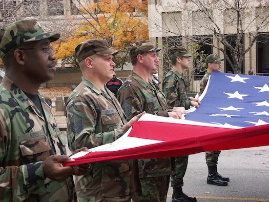 Members of the Air Force Reserve Command's 932nd Airlift Wing at Scott AFB, Ill., carry an oversized flag during a Veteran's Day parade.