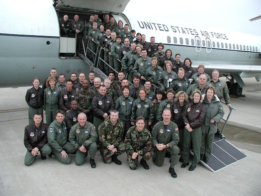 C-9A Nightingale pilots and crew members from the Air Force Reserve Command's 932nd Airlift Wing at Scott AFB, Ill., pose in front of a C-9A before its retirement. Photo by Capt. Stan Paregien.