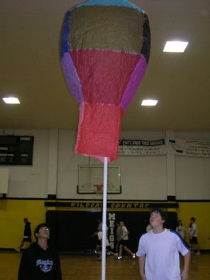 Two eighth-grade students from Meigs Middle School watch their hot air balloon rise into the air during the engineering contest last week at the school. The winning balloon stayed aloft almost 28 seconds.