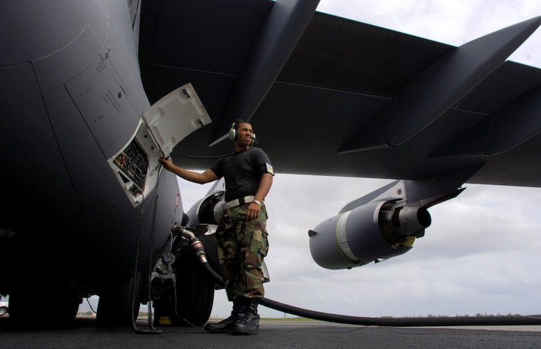 HICKAM AIR FORCE BASE, Hawaii -- Airman First Class Justin Soileau-Gobert refuels a C-17 Globemaster III. A1C Soileau-Gobert is a crew chief from the 15th Maintenance Group. The first combined active duty and Air National Guard maintenance group of its kind.