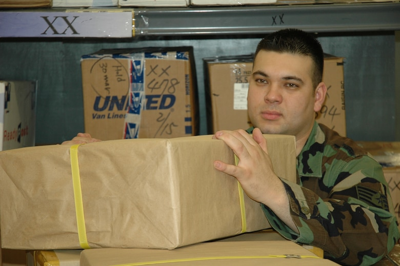 OSAN AB, Republic of Korea -- Staff Sgt. Thomas Arita, a military postal clerk with the 51st Communications Squadron, unloads packages at Osan's Post Office. Postal clerks process more than 500 pieces of mail a day.